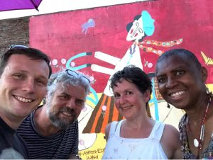 A picture of a tourist named Jon, mural artist Trés Taylor, AC Reeves and Afriye WeKandodis