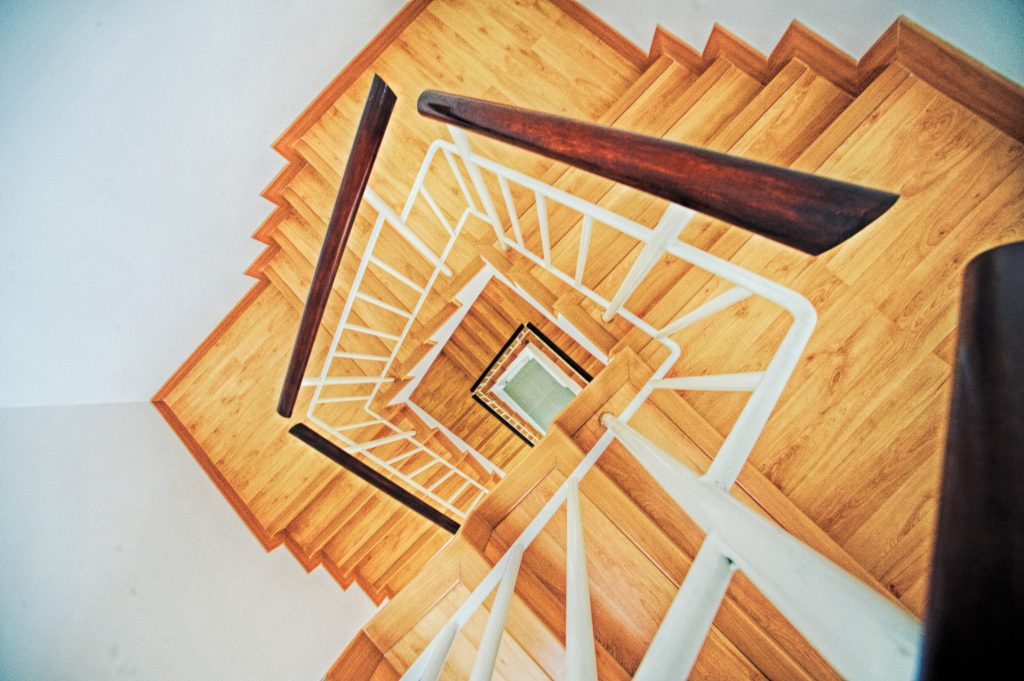 A seemeingly endless wooden staircase.